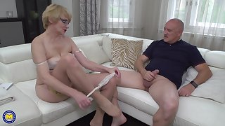 Blonde mature nerdy MILF Rina M. blows together with rides an older guy