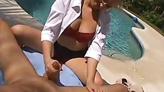 Mesmerizing MILF gives him a handjob while showing her tits