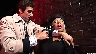 Leathered up Romana Ryder is forced to suck his dick