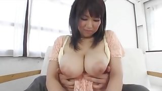 Busty Asian Babe With Monstrous Big Tits Groped From Behind