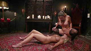 Bitches are having a wild time sharing the strap-on