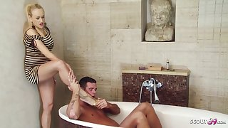 Ravishing blonde woman is having casual sex with her handsome step- son, in the bathroom